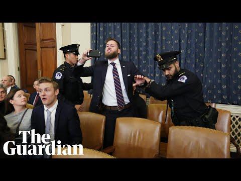 'Democrat treason': protester disrupts opening of Trump impeachment hearing
