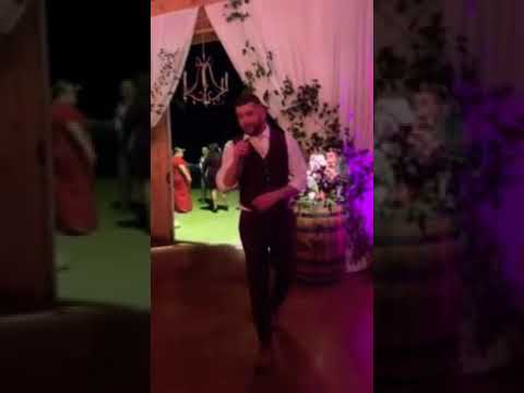 "Groom sings Brett Young ""yours to hold"" to his bride"