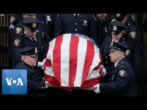 Thousands Honor Slain