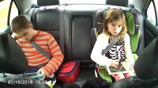 Bora & Maya in the car.