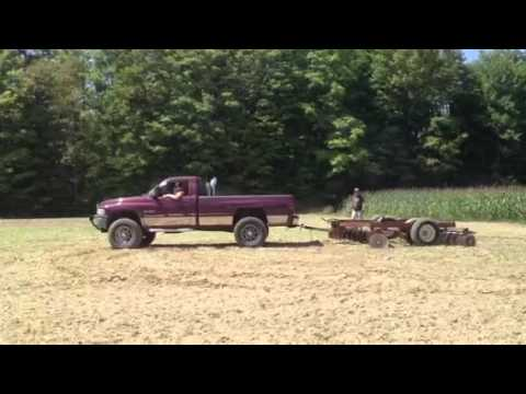 Truck pulling farm discs