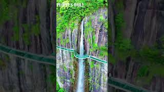 The waterfall at Tiantai Mountain is a signature beauty in the lush green mountains
