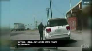 Cop yanks combative woman from SUV