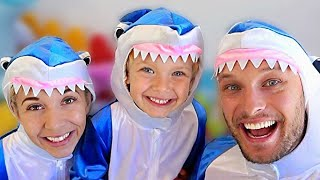 Lev and family pretend to play fun sharks