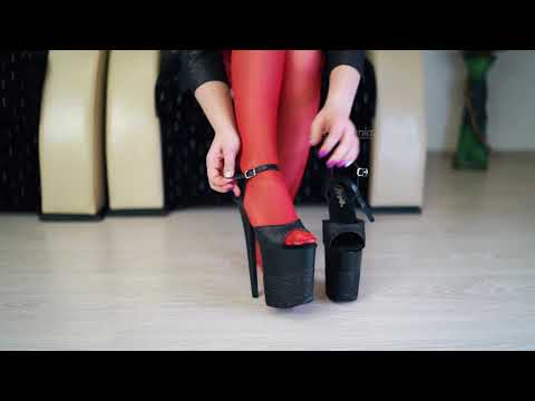 Young Mistress walking in 8inch stripper heels wearing red nylons