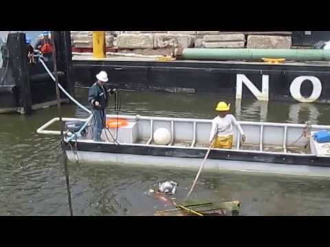 OCNJ diver attaching cable to sunken crane & barge