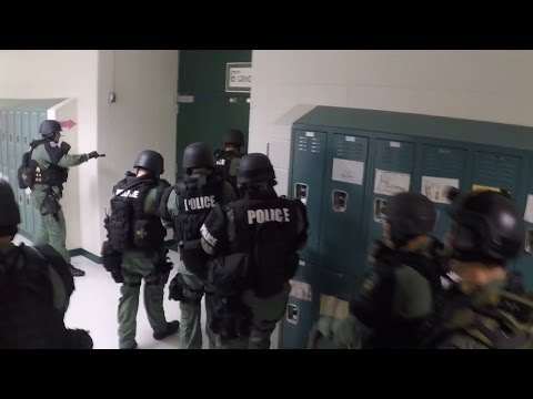 SWAT teams practice at a middle school