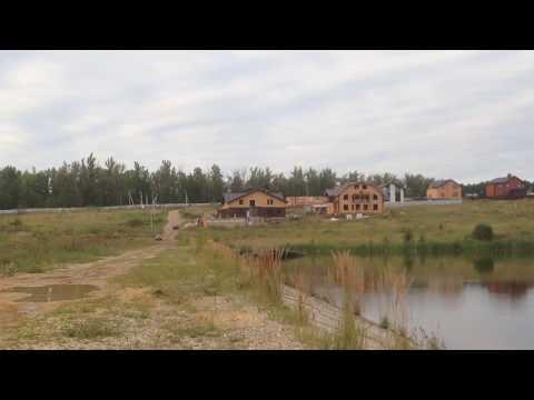 """КвадроХаусы. Вид с озера на коттеджный поселок """"Рублево - Медвенское"""""""