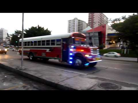 City Bus (Red Devil) Riding down the street in Panama City