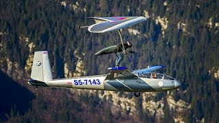 Hang Glider Touches Down on Sail Plane
