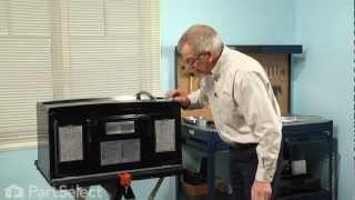 microwave repair replacing the grease filter ge part wb06x10654