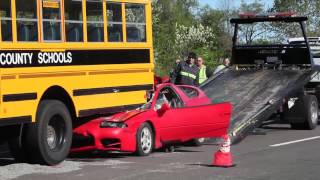 Car Drives Under School Bus