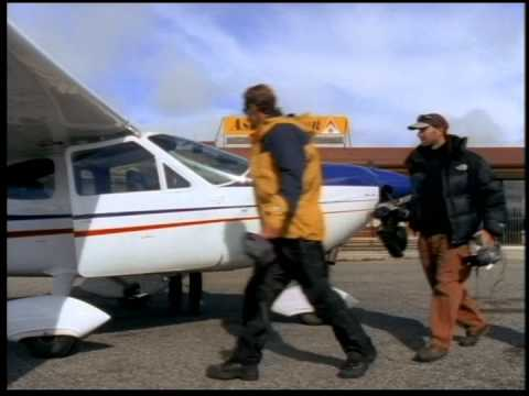 Bob Rankin and Eric Pehota survey the Southern Alps by plane by Warren Miller