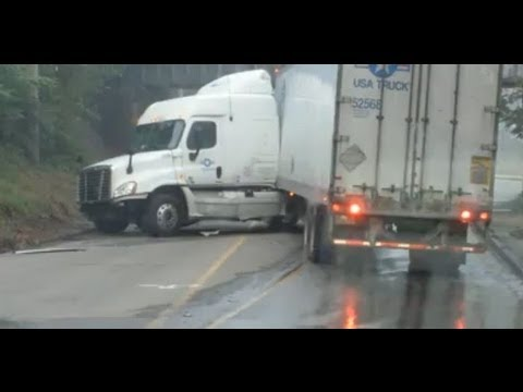 Driver Fails at Low Bridge U-Turn - USA Truck