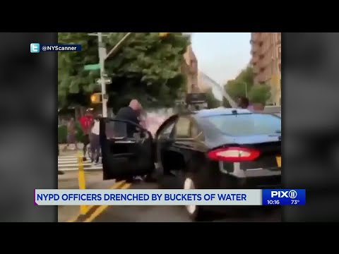 `Completely unacceptable,` Mayor condemns videos of men dumping buckets of water on NYPD officers