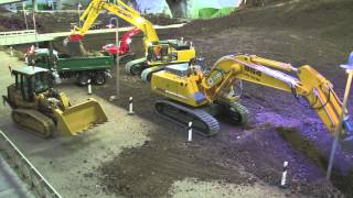 RC TRACK LOADER AND EXCAVATOR AT THE CONSTRUCTION SITE - SCALEART