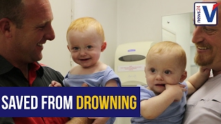 Dad clings to twins; keeps them from drowning in flooded underpass