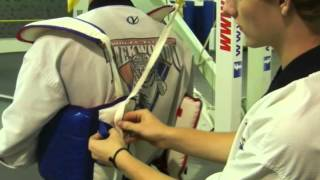 PUTTING ON SPARRING GEAR