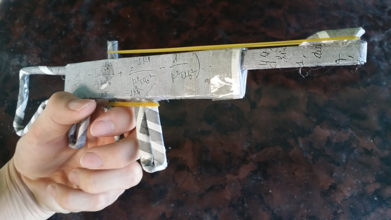 Comment faire un pistolet l 39 aide de papier qui tire armes jouets - Comment fabriquer un pistolet ...