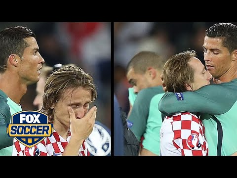 Cristiano Ronaldo consoles Luka Modric after Portugal knocks Croatia out of Euros