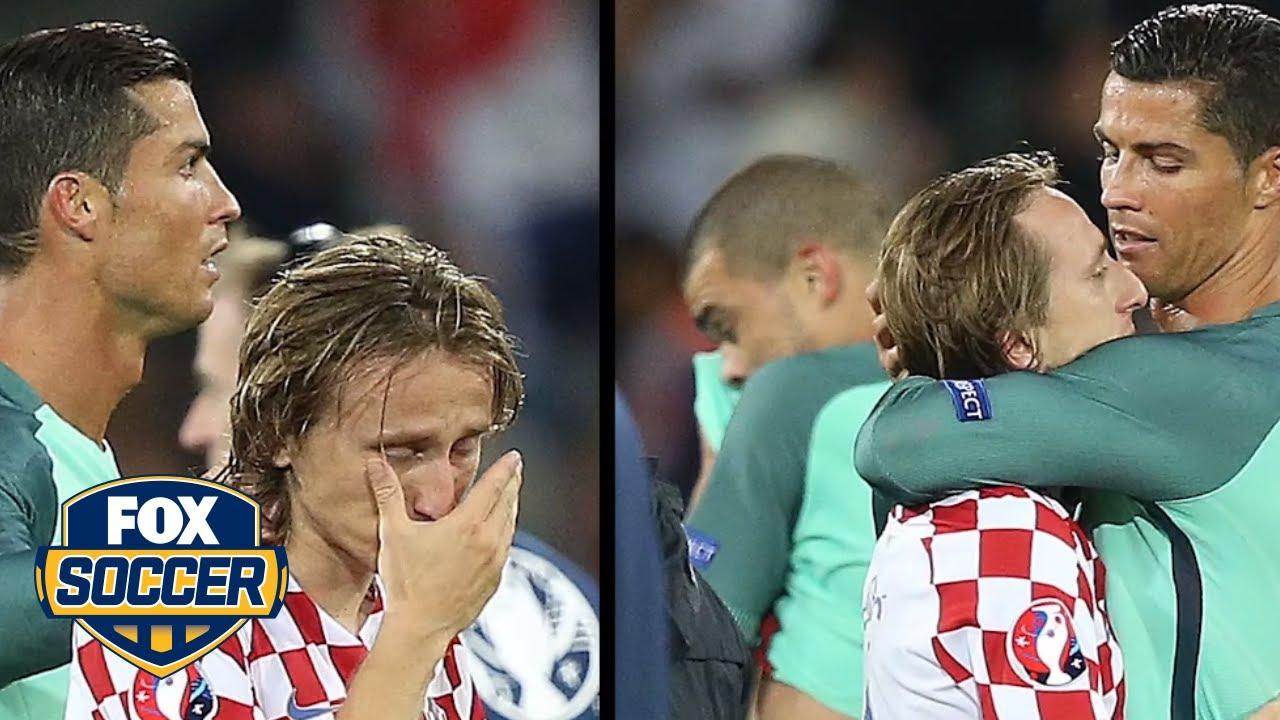 1958148a7de Cristiano Ronaldo consoles Luka Modric after Portugal knocks Croatia out