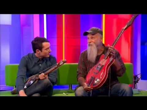 Seasick Steve  Shows Off  his Guitars to Elija Wood