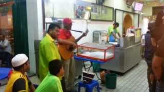 Busker outside Nasi Kandar Restaurant KL