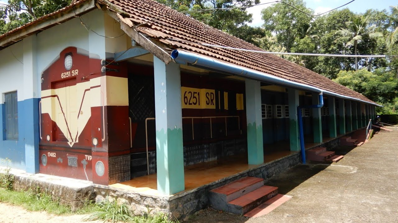 For the upcoming ferroequinologists! Govt School in Kerala repainted to a train's livery.