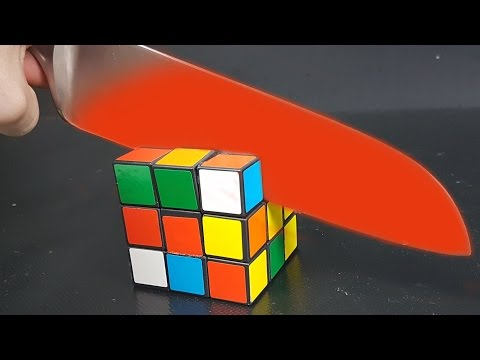 Thumbnail: EXPERIMENT Glowing 1000 degree KNIFE vs RUBIK'S CUBE
