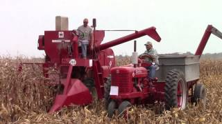 International 303  Combine Unloading on the Go with a Farmall Super M