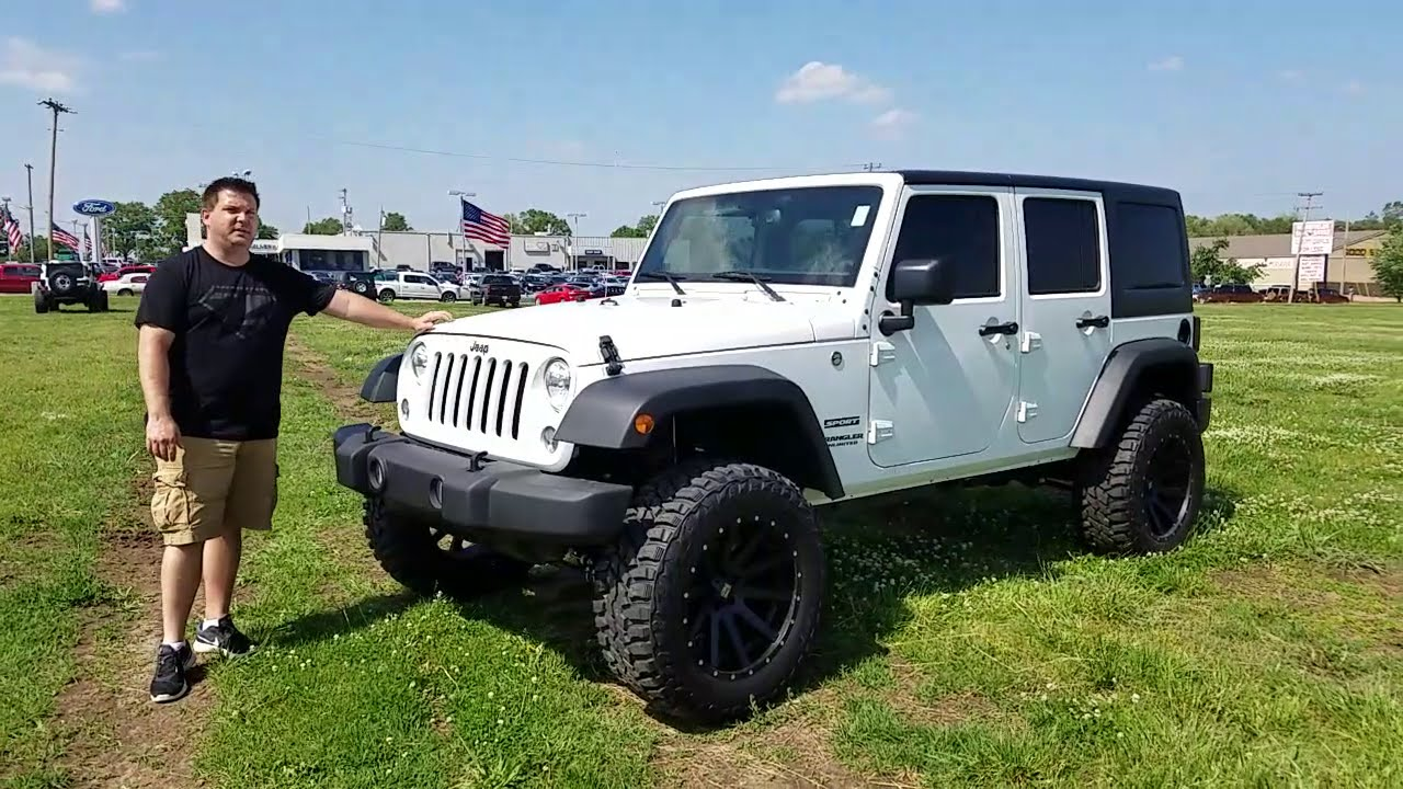 2016 Jeep Wrangler Unlimited 4 inch lift 35 inch tires - YouTube