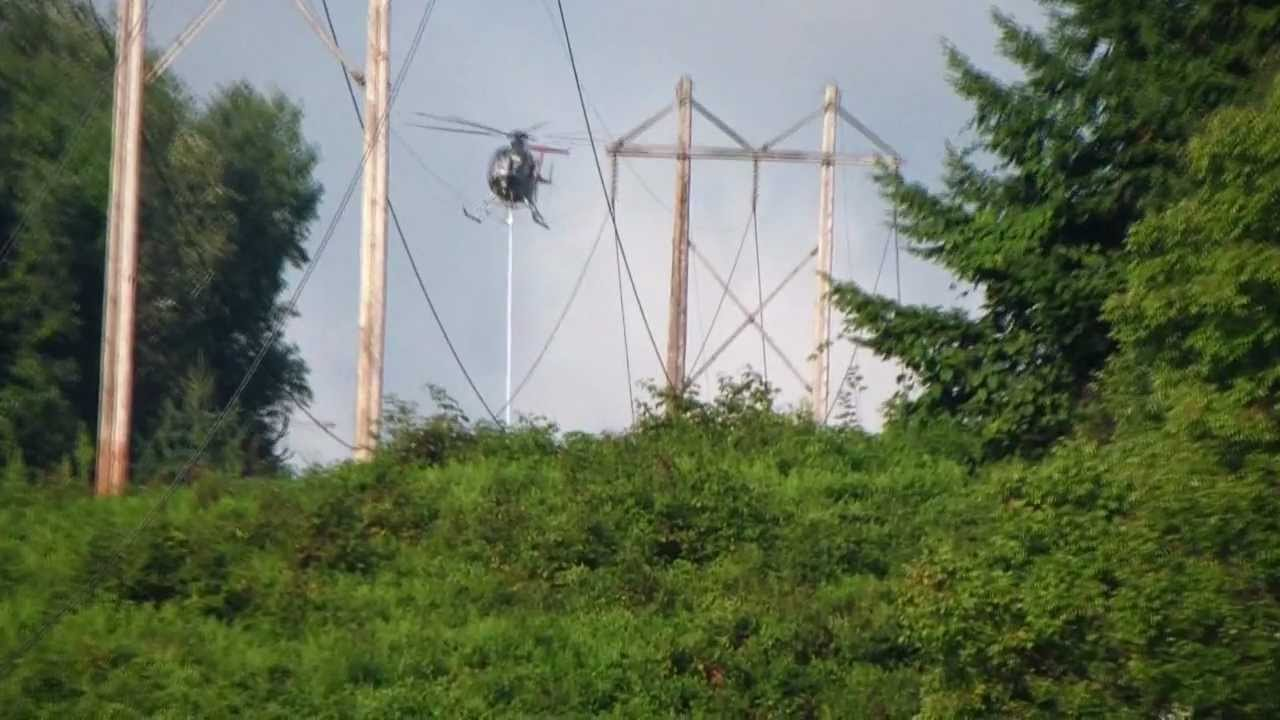 helicopter trimming trees by