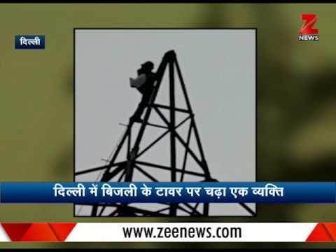 Watch: Mentally unstable man climbs high tension electricity tower in Delhi