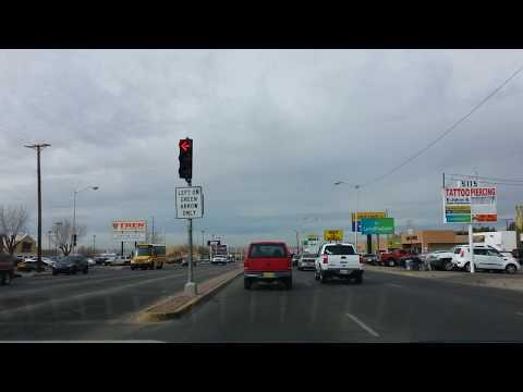 Driving down a major city street, Menaul Blvd.,  in Albuquerque New Mexico. Thrift Store Row.