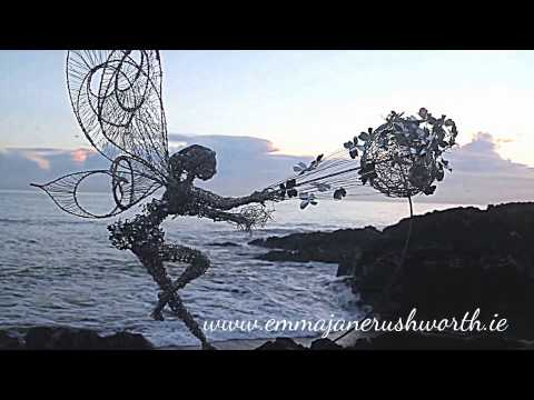 Garden Sculpture a Wire Fairy spinning in the greystones wind Ireland.
