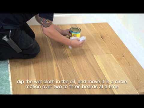 Applying maintenace oil to wood floor