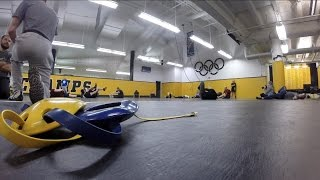 Police practice defensive tactics with Iowa wrestling team