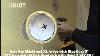 Hole Pro Dust Shield with Blue Boar Hole cutter cutting 6