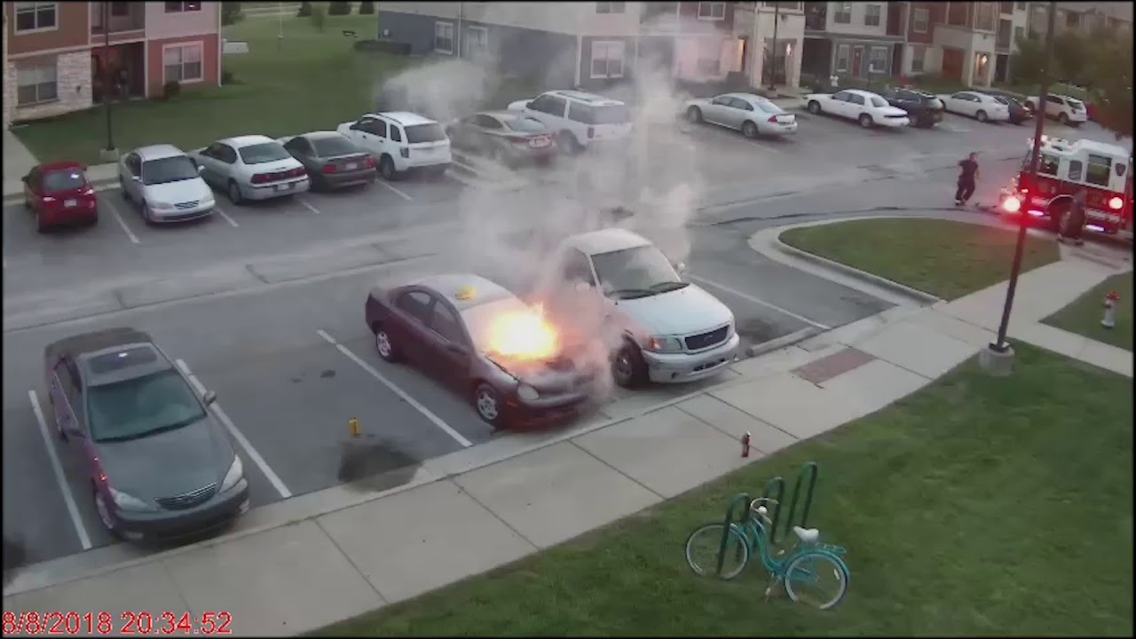 Car Catches Fire in an Apartment Parking Lot