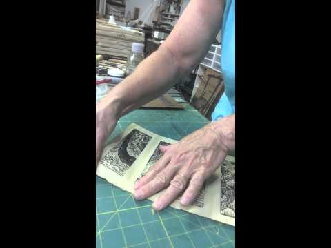 Tearing paper with water to simulate a handmade paper edge
