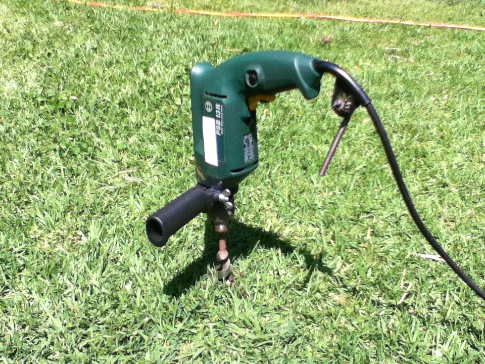 How To Aerate Your Lawn Using An Electric Drill And Wood