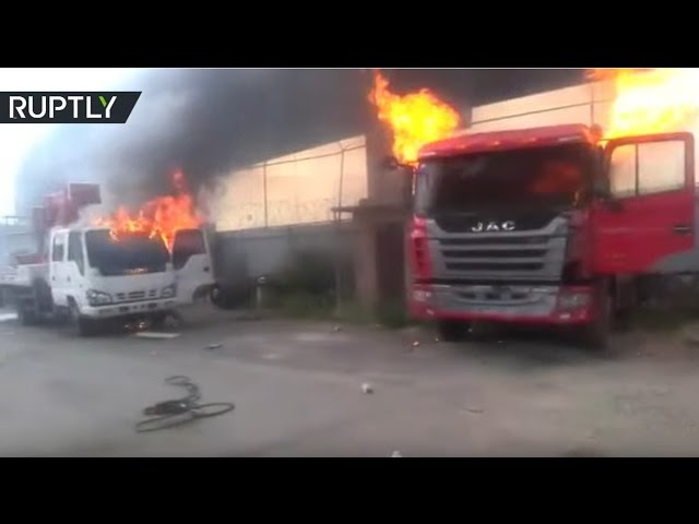 Trucks burn, police use tear gas & pellets as clashes in Venezuela enter fourth week