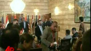 Raw Video: Iraqi Journalist Throws Shoe at Bush