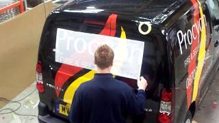 Application of Vinyl lettering graphics to commercial vehicle