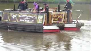 Canal boats leaving Latchford Locks on the Manchester ship canal