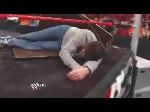 Mark Cuban Slammed through table - WWE
