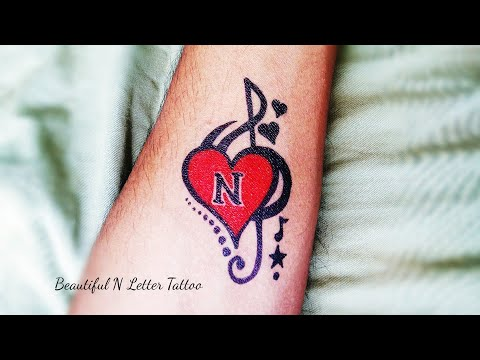 N Letter Tattoo with heart and music simble