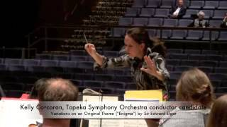 Topeka Symphony Orchestra conductor candidate Kelly Corcoran leads a rehearsal