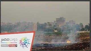 دخان حرق المخلفات الزراعية يملأ سماء أسيوط