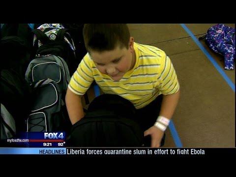 Underprivileged kids given school supplies at Dallas event